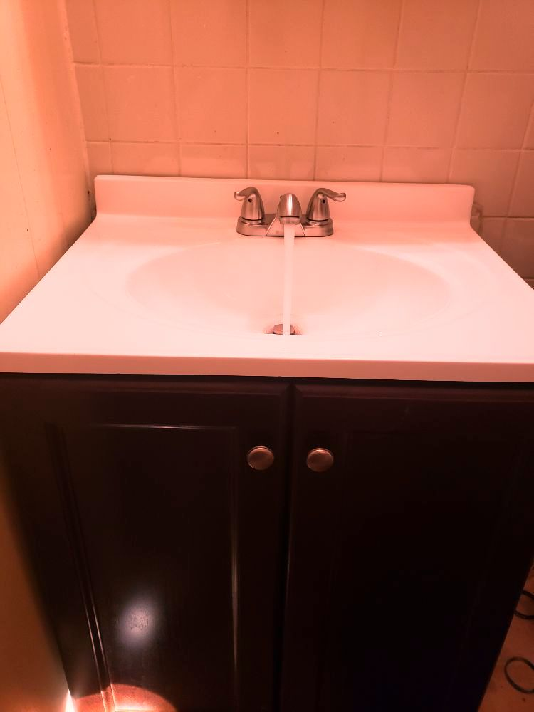t l back plumbing sink installation